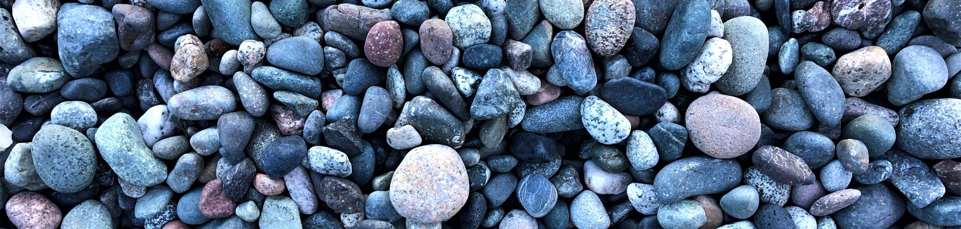 grey and red pebbles on a beach