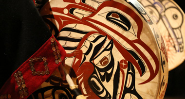 First Nations drum with black and red painting of a raven