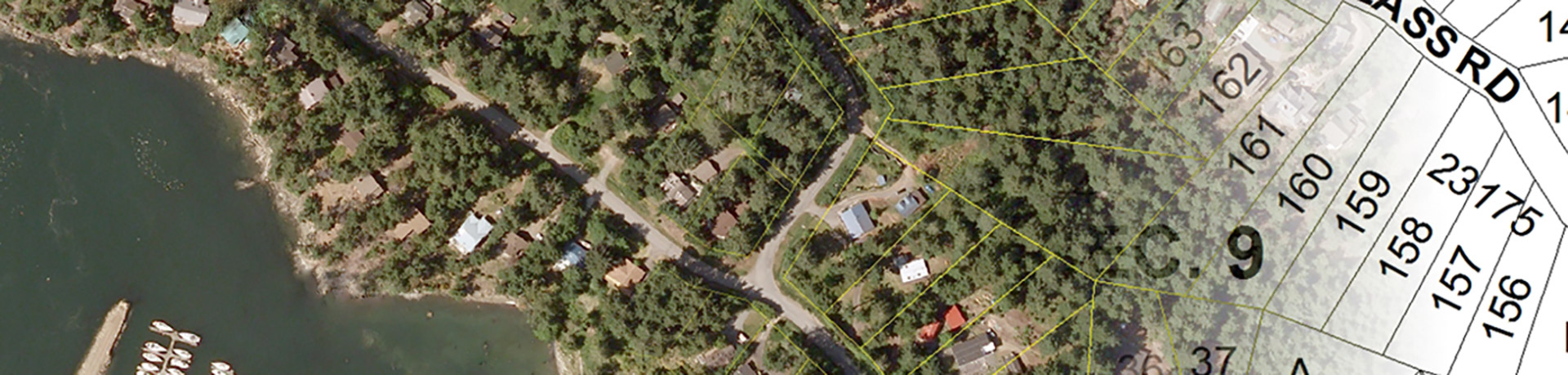 Aerial photo of a neighbourhood in the trees with coordinates overlaid on the image