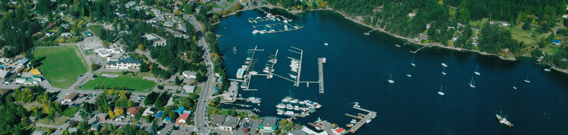 Aerial view of a harbour town in an ocean bay