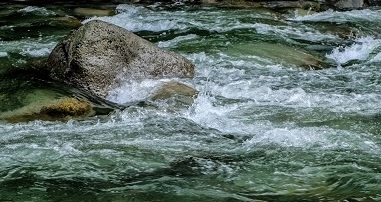 river water washing over rocks