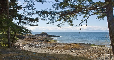 view of the ocean from a sandy and rocky west coast shoreline