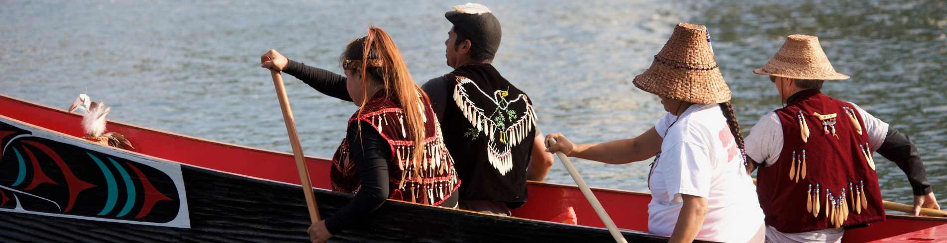 First Nations canoe with paddlers